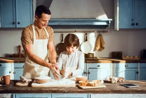 padre che insegna cucinare figlio guetzli